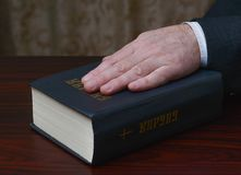 hand-holy-book-bible-49705276.jpg