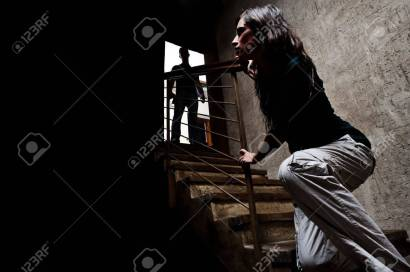 8726630-concept-of-domestic-abuse-battered-woman-escaping-from-man-silhouetted-at-the-top-of-the-stairs-in-f.jpg