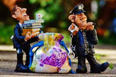 taxes-tax-evasion-police-handcuffs.jpg