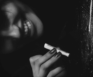 woman holding a blunt